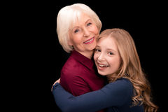 Grandchild and grandmother hugging Stock Image