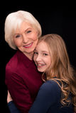 Grandchild and grandmother hugging Royalty Free Stock Photography