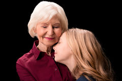 Grandchild and grandmother hugging Stock Photos