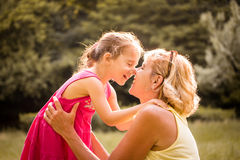 Grandchild and grandmother touching with noses Stock Image