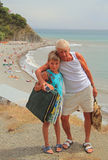 Grandchild and grandpa against the background of. The sea beach Royalty Free Stock Photography