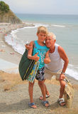 Grandchild and grandpa against the background of. The sea beach Stock Photo