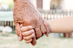 Grandchild and grandparent Stock Photos
