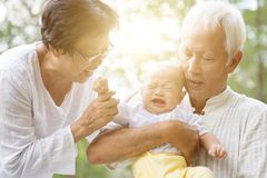 Grandfather, grandmother and grandson outdoors. Stock Photo