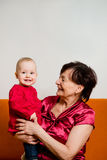 With grandchild - happy retirement Royalty Free Stock Photography