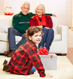 Grandchild opening gift at Stock Image