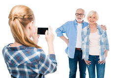 Grandchild taking photo of grandmother and grandfather Stock Images