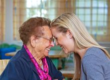 Grandchild visits grandmother. A grandchild visiting his grandmother. listen to the conversation Stock Images