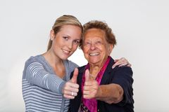 Grandchild visits grandmother. A grandchild visiting his grandmother. laughter and joy. thumbs up Stock Photography