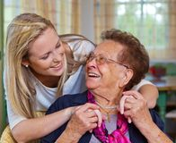 Grandchild visits grandmother. A grandchild visiting his grandmother. fun and joy in the embrace Stock Image
