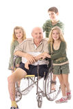 Grandchildren with Grandfather. In wheelchair Stock Photos