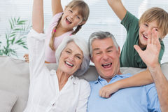 Grandchildren and grandparents raising their arms Royalty Free Stock Image