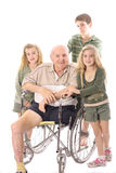 Grandchildren with handicap Grandfather in wheelch Stock Images
