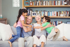 Grandchildren playing with grandparents Royalty Free Stock Photography