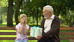 Granddad gives birthday present to grandson, dreams come true, child happiness stock footage
