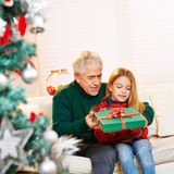 Granddad giving gift to granddaughter Royalty Free Stock Photo