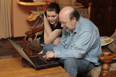 Granddad and grandchild at laptop PC Stock Image