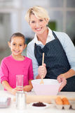 Granddaughter baking with grandmother Stock Photography
