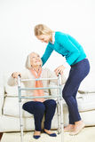 Granddaughter caring for grandmother Royalty Free Stock Photo