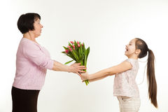 The granddaughter congratulates the grandmother Stock Image