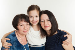 The granddaughter embraces the grandmother and mother Royalty Free Stock Image