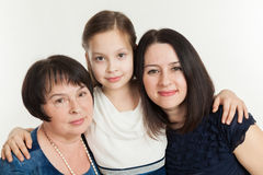 The granddaughter embraces the grandmother and mother Stock Photo