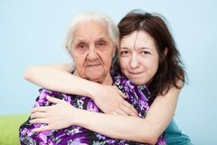 Granddaughter embraces her grandmother Stock Photography