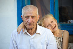 Granddaughter embracing with grand parents Royalty Free Stock Photography