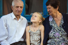 Granddaughter embracing with grand parents Stock Image