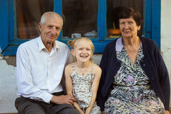 Granddaughter embracing with grand parents Stock Photography