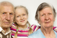 Granddaughter with grandfather and grandmother Royalty Free Stock Photography