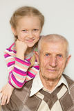 Granddaughter and grandfather Royalty Free Stock Image