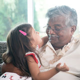 Granddaughter and grandfather. Portrait Indian family at home. Grandparent and grandchild close up face. Asian people living lifestyle. Grandfather and Royalty Free Stock Photos
