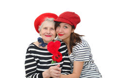 Granddaughter and grandma with red heart Royalty Free Stock Photos