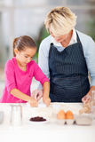 Granddaughter grandmother baking Royalty Free Stock Photos