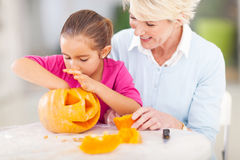 Granddaughter grandmother halloween pumkin Stock Photography