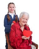 Granddaughter and grandmother with hearts Royalty Free Stock Photos