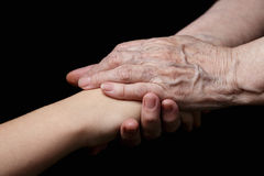 Granddaughter and grandmother holding hands Stock Photography