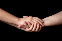 Granddaughter and grandmother holding hands Royalty Free Stock Image