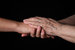 Granddaughter and grandmother holding hands Royalty Free Stock Photos