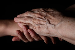 Granddaughter and grandmother holding hands Stock Photo