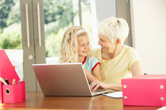 Granddaughter And Grandmother At Home Stock Photography