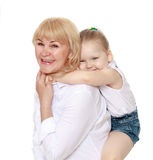 Granddaughter and grandmother hugging Stock Photo