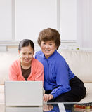 Granddaughter and grandmother on laptop Royalty Free Stock Photo