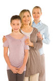 Granddaughter grandmother young mother standing on white backgro Royalty Free Stock Photo