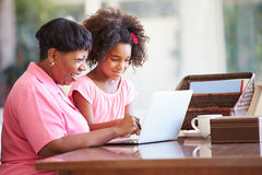 Granddaughter Helping Grandmother With Laptop Royalty Free Stock Photos