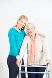 Granddaughter helping senior woman Stock Photography