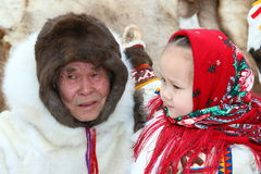 Granddaughter and her grandfather in the Nenets national costume Royalty Free Stock Photo