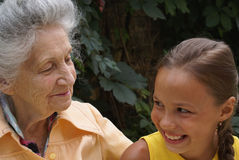 Granddaughter and her grandmother Stock Images