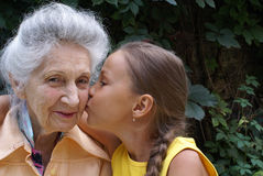 Granddaughter and her grandmother Royalty Free Stock Photos